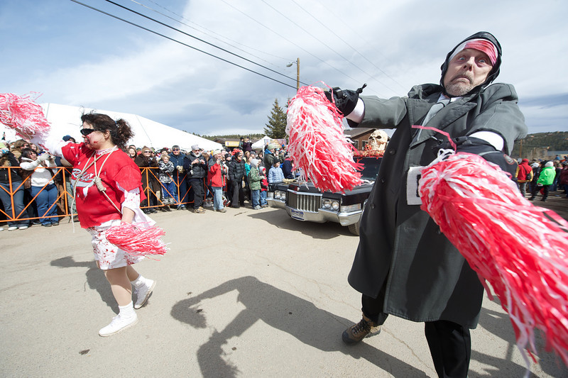 Walt Hester | Trail Gazette<br /> Zombie cheerleaders lurch up the parade route in front of Demonica's customized hearse on Saturday. Zombies, and the people who love them were out in force in Nederland.