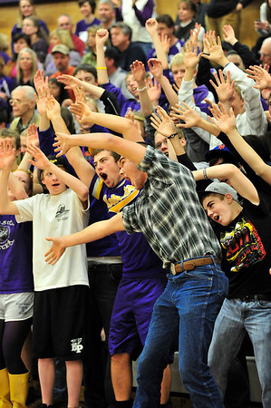"Walt Hester | Trail Gazette<br /> Sam KellerTwigg leadfs the home fans in the famous ""Roller Coaster"" cheer during Thursday's Ladycats basketball game. The girls play again Thursday in the Sweet Sixteen round of the state basketball playoffs."