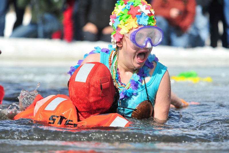 Walt Hester | Trail Gazette<br /> Nederland Dive Rescue member helps a polar plunger out of the water during the charity event. Water temperatures, as one might imagine, were in the 30s for those brave, or perhaps foolhardy, enough to take the plunge.