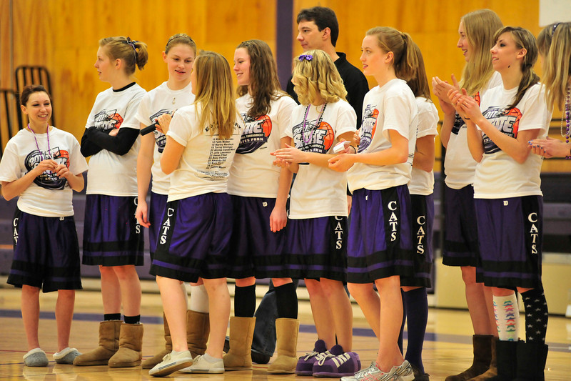 Walt Hester | Trail Gazette<br /> Estes Park High School's Ladycats basketball team stands before their class mates at a pre-game pep rally on Thursday. The girls traveled to Moby Arena in Fort Collins to take on Pagosa Springs, the team that knocked them out of contention during last season's tournament.