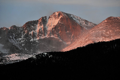 Walt Hester | Trail Gazette Strong winds blow snow off of Mount Lady Washington and across the Diamond as the sun rises on Saturday. Winds above 80 miles per hour are not unusual across the high peaks in Rocky Mountain National Park.