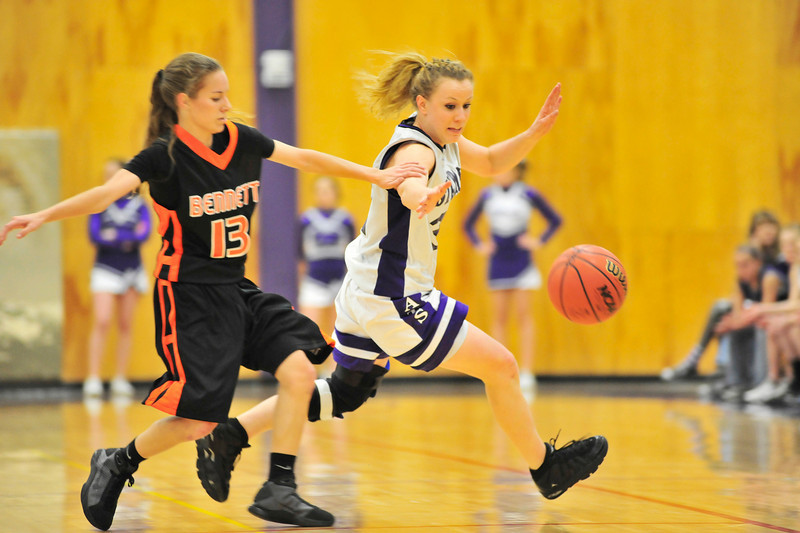 Walt Hester | Trail Gazette<br /> Kyra Stark knocks the ball free from Bennett's McKayla Hicks for another steal and another score in the first half of Friday's first-round playoff game. The Ladycats' relentless defense held the visiting Tigers to three points in the first half, winning 55-22.