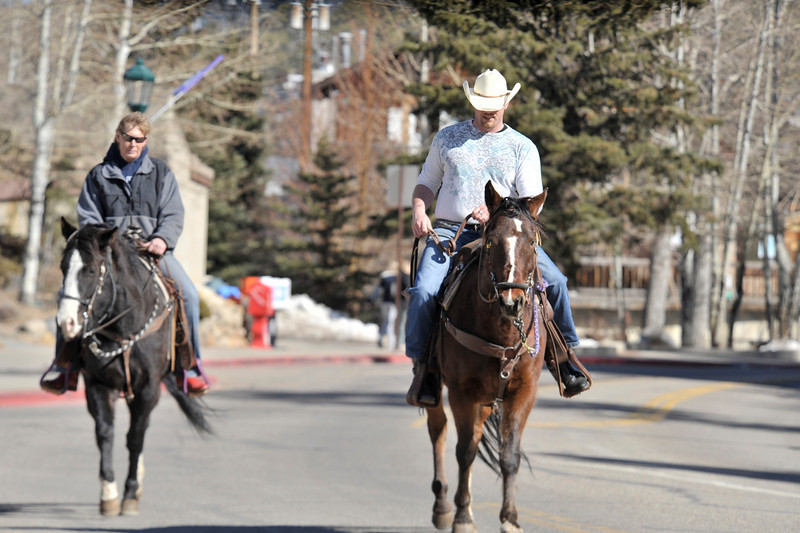 Walt Hester | Trail Gazette<br /> Jodi O'Dell, left, and Jonathan Kelley, both of Estes Park, take advantage of Wednesday's sunshine and ride through town. Friday and Saturday are expected to be mild, with possible snow on Sunday.