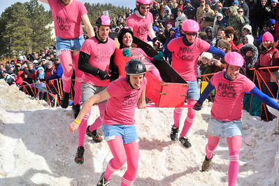Walt Hester | Trail Gazette Thousands of visitors jam a hillside in Chipeta Park in Nederland to watch the Coffin Races. Teams carry a coffin of their own making through a frozen obstical course and into a Tuff-Shed.