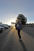 Walt Hester | Trail Gazette<br /> Morning shadows folow Rick Life across a parking lot as the late winter sun rises above Estes Park on Wednesday. Next week, the sun won't be up as early, as we return to Daylight Savings Time on Sunday morning.