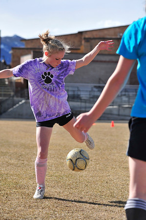 Walt Hester | Trail Gazette<br /> Hanna Steadman gains control of a ball during warm up drills on Wednesday. Athletes played as many as three games on Saturday.