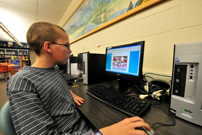 Walt Hester | Trail Gazette<br /> Michael Ryan, 12, enjoys some playtime during lunch at Estes Park Middle School on Wednesday. Other kids read after eating, using extra time in quiet ways.