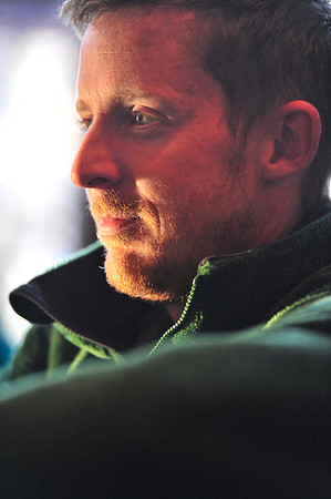 Walt Hester | Trail Gazette<br /> Accomplished climber and Estes Park native Tommy Caldwell is bathed in late afternoon light while watching the St. Baldrick's celebration on Sunday. Caldwell's father, local fishing guide and climbing coach Michael Caldwell, was the events Master of Ceremonies.