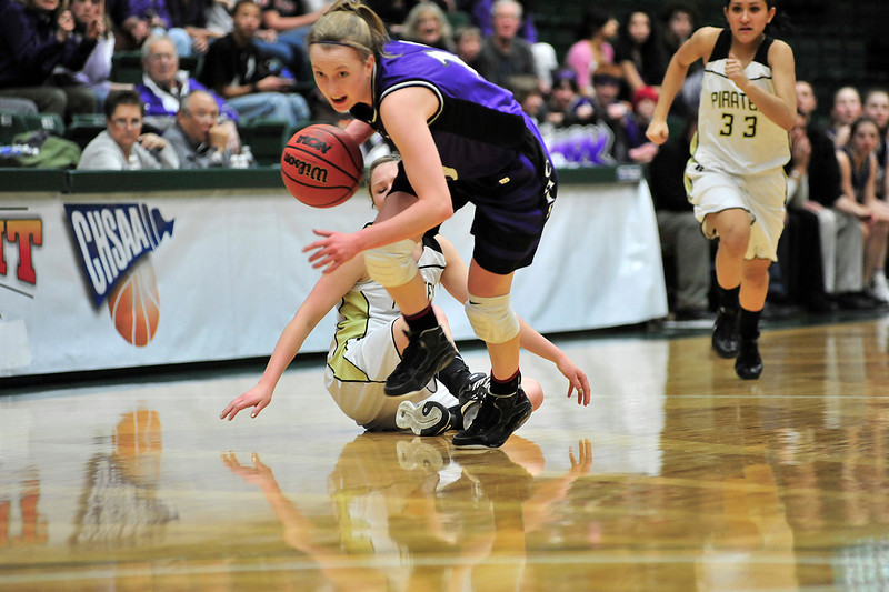 Walt Hester | Trail Gazette<br /> Kimmy Hansen steals the ball from Pagosa Springs' Breezy Bryant in the second quarter of Thursday's quarterfinal game between the Ladycats and the Pirates. The defense sparked a comeback in the first half, tying the game at 18 at the half, but the Ladycats' shooters turned cold, allowing the Pirates to eke out the 35-34 win. The girls will play Friday at 1:30.