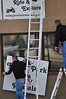 Walt Hester | Trail Gazette<br /> Local business owners Troy and Travis Kerns arrange signs above a storefront along Elkhorn Avenue on Wednesday. A few businesses are beginning to ramp up in anticipation of spring in Estes Park.