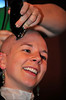 Walt Hester | Trail Gazette<br /> Caitlin Hammer of Estes Park smiles as the last of her hair comes off. As the event has grown, teachers, business owners, firefighters, police and of course the Estes Park Mountain Shop have all sacrificed hair to raise money to fight childhood cancer.