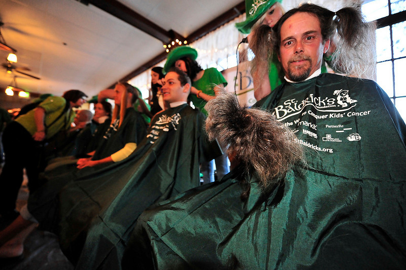 Walt Hester | Trail Gazette<br /> Jerry Schrag shows off some of the hair he grew for three years just for this event. Schrag raised $365 for the foundation.