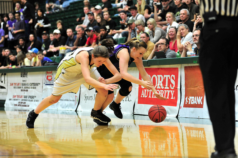 Walt Hester | Trail Gazette<br /> Ladycats' Kyra Stark races Pagosa Springs' Mary Brinton to a loose ball in the first half of the quarterfinal tilt between the 'Cats and the Pirates. The Estes Park girls' shooting fell cold in the second half, allowing the Pagosa Springs girls to squeek past the Ladycats, 35-34.