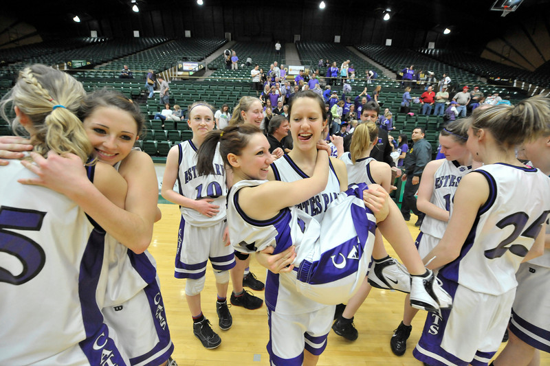 Walt Hester | Trail Gazette<br /> The Estes Park Ladycats basketball team celebrates after winning the consolation championship at Moby Arena in Fort Collins on Saturday. It was not the state title that the girls wanted, but they were able to finish the season and for the seven seniors, a career, with a win.