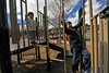 Walt Hester | Trail Gazette<br /> Saam, left, and Nima Kadivi of Dallas climb and play on equipment along Riverside Drive near Elkhorn Avenue on Wednesday. Mild spring-like temperatures coaxed people outside to enjoy the sunshine.
