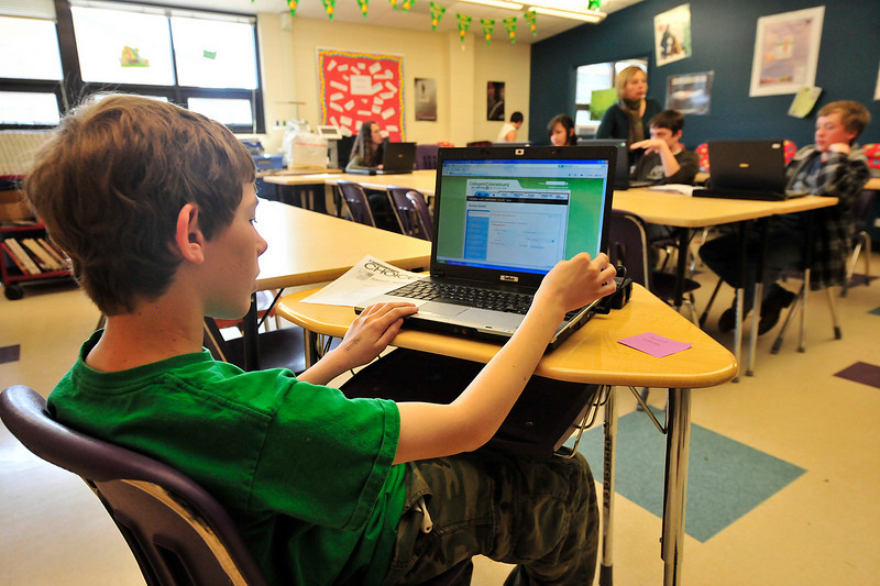 Walt Hester | Trail Gazette<br /> Nathen Reves, 14, and class mates work on a resumes in Sue Meadows' Life Skills-8 class on Wednesday. Reves hopes to land a summer job at Fun City with his resume.
