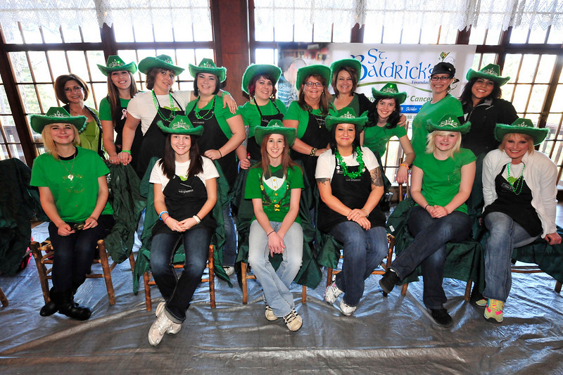 Walt Hester | Trail Gazette<br /> The ladies of Hair Dynamics of Fort Collins awaits the shavees at the St. Baldrick's celebration at the Crags on Sunday. While shaving many a head, at least one shaver also became a shavee.