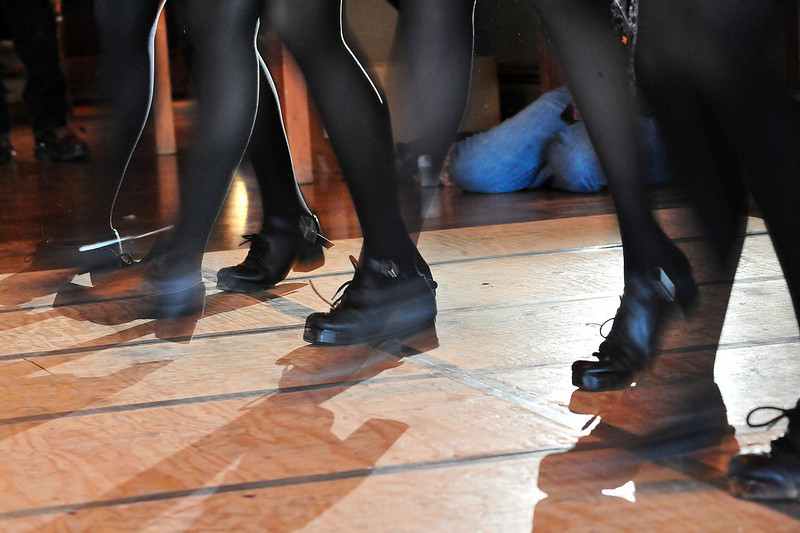 Walt Hester | Trail Gazette<br /> The flying feet of the McTaggart school of Irish Dance entertain the crowd at the Crags on Sunday. The Irish dance school annually shows their fancy footwork at the Estes Park St. Baldricks fund raiser.