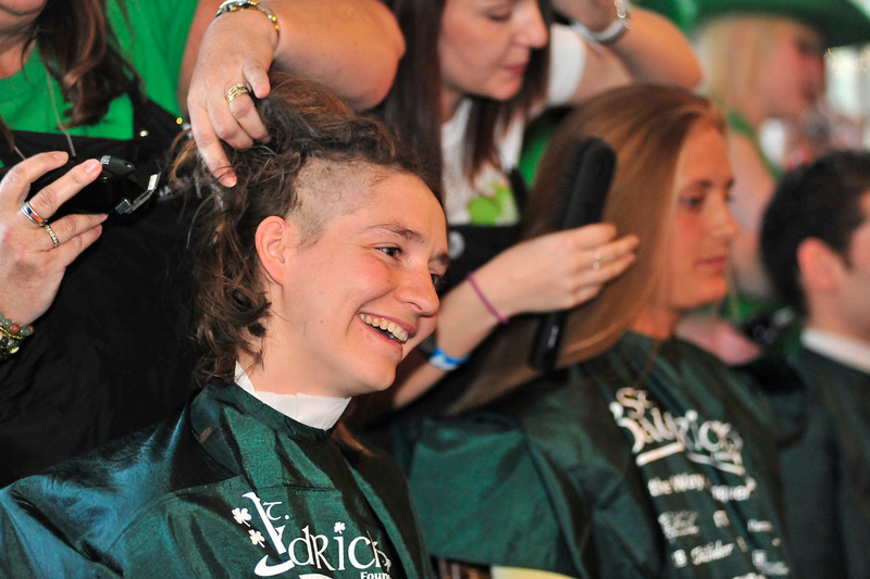 Walt Hester | Trail Gazette<br /> Maisie Rinne smiles while her locks tumble off. Rinne gathered $4,500 to shave her head for St. Baldricks.