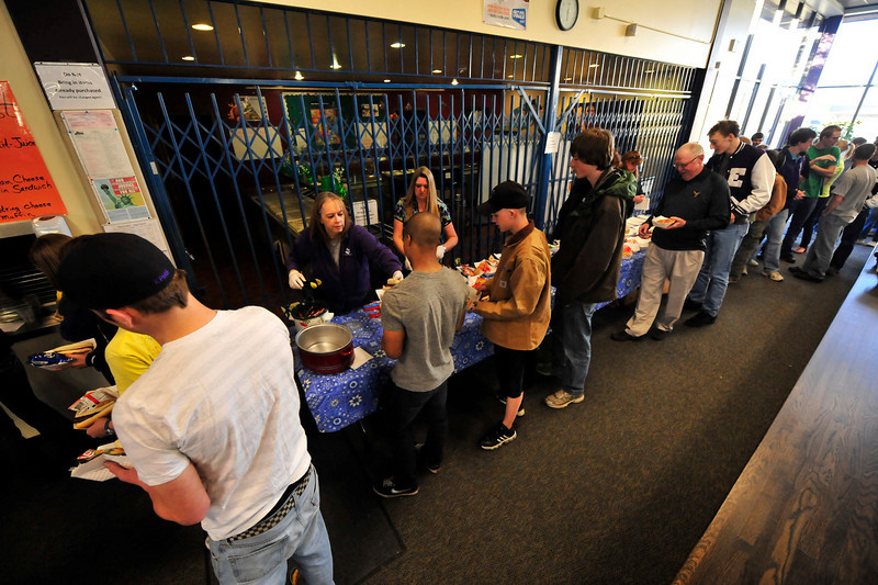 Walt Hester | Trail Gazette<br /> Athletes, families and fans line up for dinner at the spring sports Meet the Bobcats night at the Estes Park High School on Tuesday. The event introduces the athletes from the spring sports teams to the public.