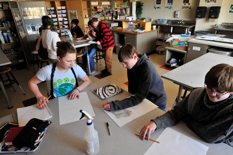 Walt Hester | Trail Gazette<br /> Eighth-grade artists work on self-portraits in class on Wednesday. Students are trying to complete projects before spring break.