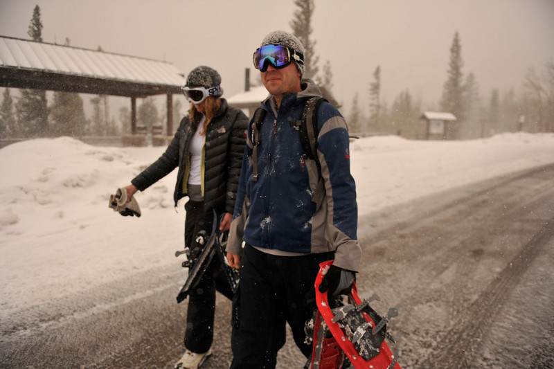 Walt Hester | Trail Gazette<br /> Joe Tonsager and Kristen Shoup, both of Denver, head to their car through a quick-hitting snow storm at the Glacier Gorge trailhead on Sunday. Weather went from warm and sunny on Saturday to cold and snowy on Sunday.