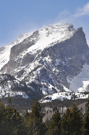Walt Hester | Trail Gazette<br /> Snow drapes over Hallett Peak above Rocky Mountain National Park on Tuesday. The bright snow and sunshine bely the up slope snow that would follow on Wednesday morning.
