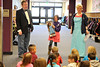 Walt Hester | Trail Gazette<br /> Sid Scott, left, Zoe Hester, 9, and Sara Bergsten tell the Estes Park Elementary School's first-graders  on Friday about the Parent-Teacher Organizations upcoming Father Daughter Dance scheduled for Friday, April 15. As part of the fun, the PTO with give away two American Girl dolls to a pair of lucky Estes Park girls at the dance.