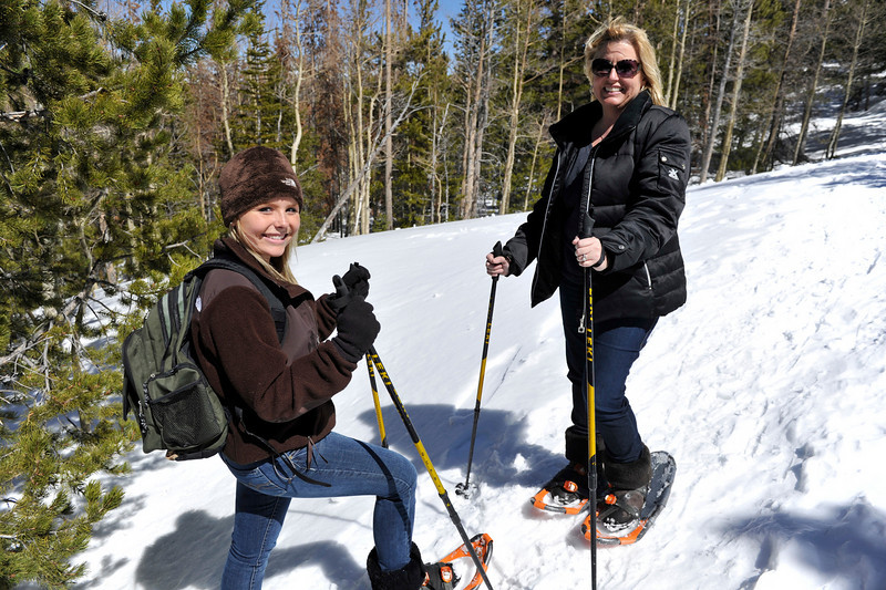 Walt Hester | Trail Gazette<br /> Rachel, 15, and Pam Hawkins from Indianapolis, Ind. hike across wet, sticky spring snow on their way to Alberta Falls on Tueday. More snow is in the forecast for the weekend.