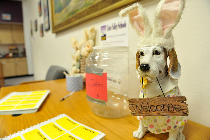 Walt Hester | Trail Gazette<br /> A seasonally-decorated dog sculpture greets visitors to the office at the Estes Park Elementary school on Friday.