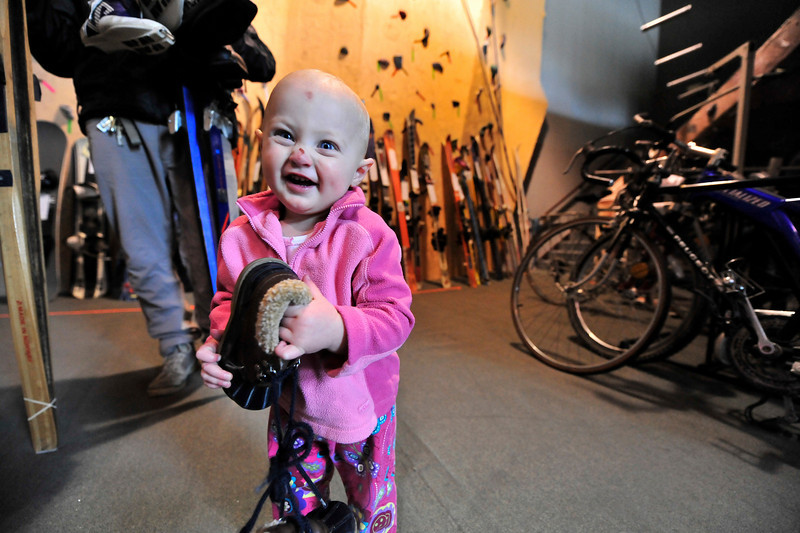 Walt Hester | Trail-Gazette<br /> Claira Amschler, 1, seems very happy about her new shoes her parents found at Saturday's Estes Vally Recreation and Parks Department All-Sports Swap Meet. The Estes Park Mountain Shop has hosted the swap meet for several years.