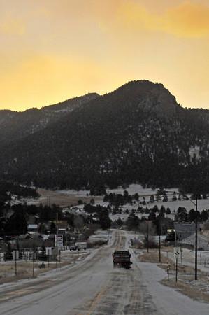 Walt Hester | Trail-Gazette<br /> Sun rises over Estes Park on Monday as plows clear new snow off of Big Thompson Avenue.