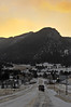 Walt Hester | Trail-Gazette<br /> Sun rises over Estes Park on Monday as plows clear new snow off of Big Thompson Avenue.