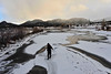 Walt Hester | Trail-Gazette<br /> An Eagle Rock student tromps across the ice at the inlet of the Big Thompson into Lake Estes on Monday. The students are involved in a program with the Division of Wildlife in which citizens help monitor the qulity of waterways around the state.