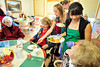 Walt Hester | Trail-Gazette<br /> Denise Palacios, standing, right, Holli Holmes and Emilee Holmes, behind Holly, clear lunch plates at the Estes Valley Senior Center on Tuesday. The girls are members of the Estes Park Middle School Student Council.