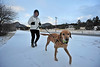 Walt Hester | Trail-Gazette<br /> A local Estes Park jogger and her training partner make their way over new snow along Mall Road on Monday. Snow and cold are likely to be the biggest obstales to outdoor activity over the Thanksgiving weekend.