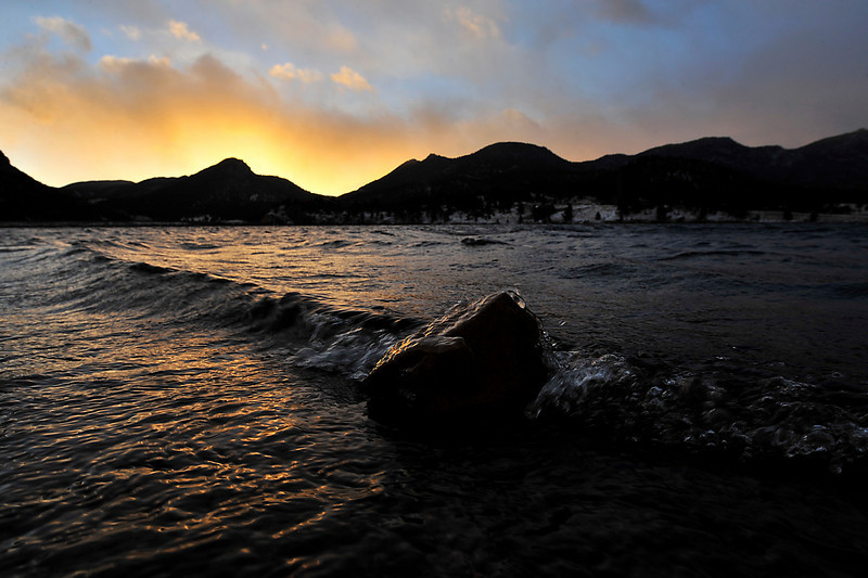 Walt Hester | Trail-Gazette<br /> An icy, wind-driven wave breaks over a small rock in Lake Estes on Monday. The snow and cold of Monday was to be the first of a series of storms dumping snow on the high country this week.