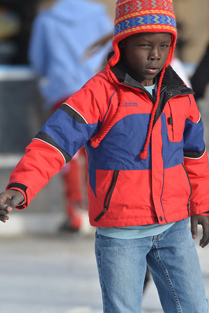 Five-year-old Uchan Kohring of Prairie Village, Kans.slowly shuffles across the Estes Park ice rink on Saturday, November 24. While refrigerated, the ice sheet is a challenge to maintain in the mountain sunshine.
