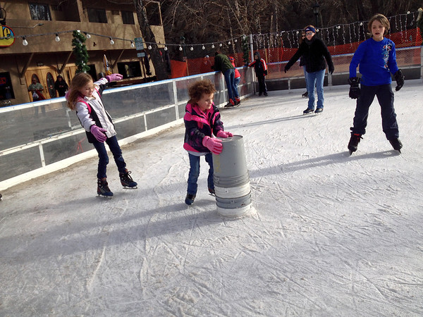 hildren of all ages take advantage of warm weather to visit the town ice rink.