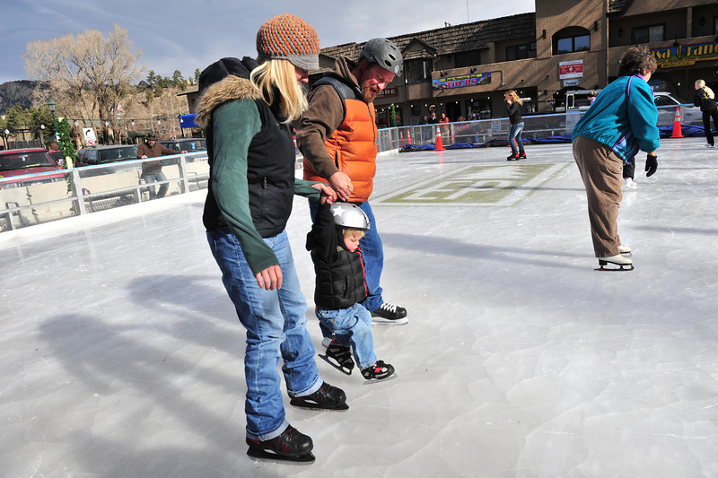 30EPIce LearningCurve.jpg A family attempts to teach its youngest member how to manage the slippery surface. Visitors to the rink will soon have more practice time as the Recreation District plans to expand the rink's hour of opporation.