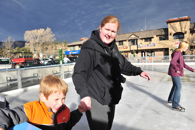 Olivia Davis leads Isaiah, 6, around the Estes Park ice rink on Wednesday, along with Cathryn Anderson, 12, all from Colorado Springs. The rink has been a big hit with visitors and locals.