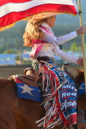 Chenae Shiner gallops past during the opening of Wednesday night's Rooftop Rodeo. The evening was marked by the annual Tough Enough to Wear Pink breast cancer awareness night.