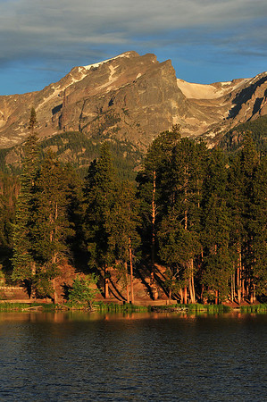 Morning sunshine bathes Rocky Mountain National Park in warm light on Tuesday. WIth continued dry and hot weather, visitors are encouraged to observe fire restrictions in the park and in town.
