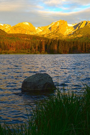 Thursday's first light color mountains and reflect off of Sprague Lake on Tuesday. The lake is a favprite spot in the national park for photographers.