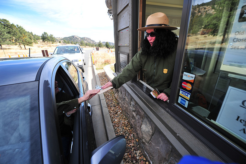 Cars line up at the Beaver Meadows Entrence Station on Saturday to enter the park for the first time since the start of the Federal budget impasse. Western governors made a deal with federal officials to open a few western national parks for 10 days, beginning Saturday.