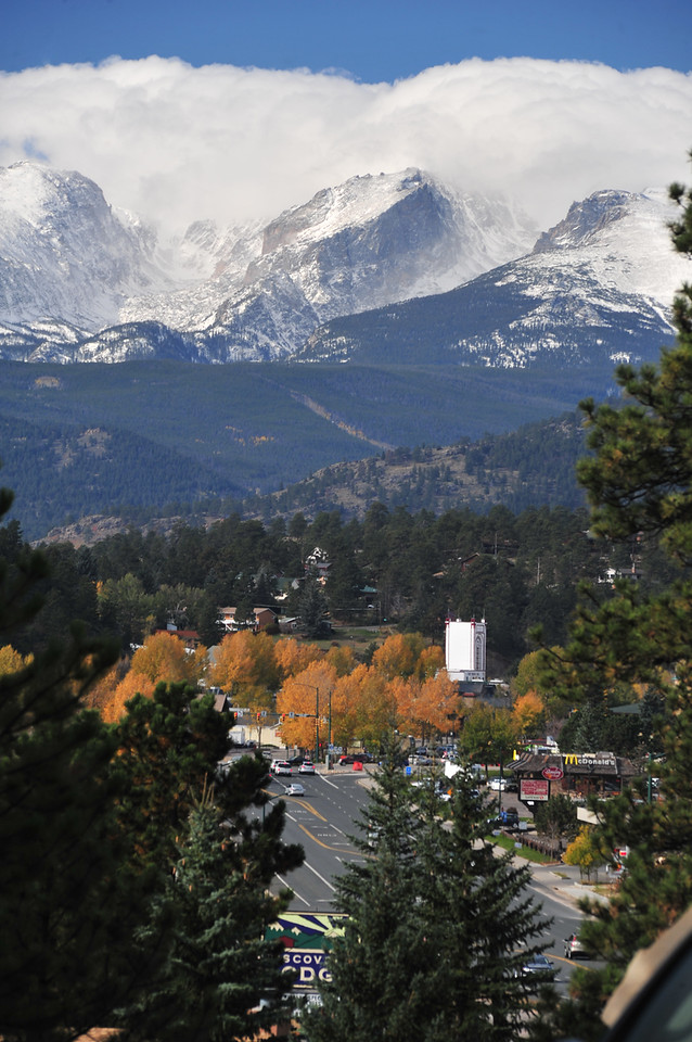 Clouds cling to the high peaks of Rocky Mountain National Park on Saturday. Visitors could get a closer look as the state and ferderal governments made an agreement that would temporarily re-open Rocky and a few other national parks in western states.