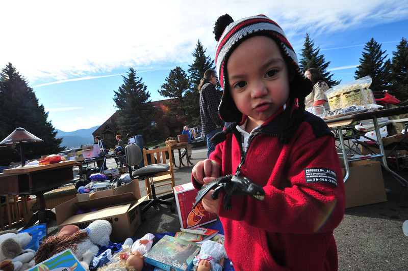 A young visitor to the Our Lady of the Mountains Catholic Church's rummage sale grabs the perfect toy on Saturday.