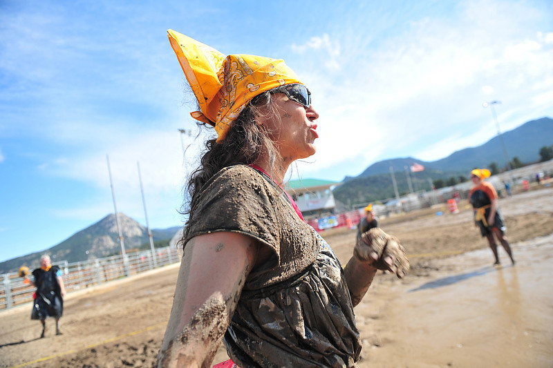 Estes Valley Library Director gets messy for a cause at the Stanley Fairgrounds on Saturday. Eagle Rock School organized the Flood Mud Volleyball Tournament, a fund raiser for Estes Valley flood relief.
