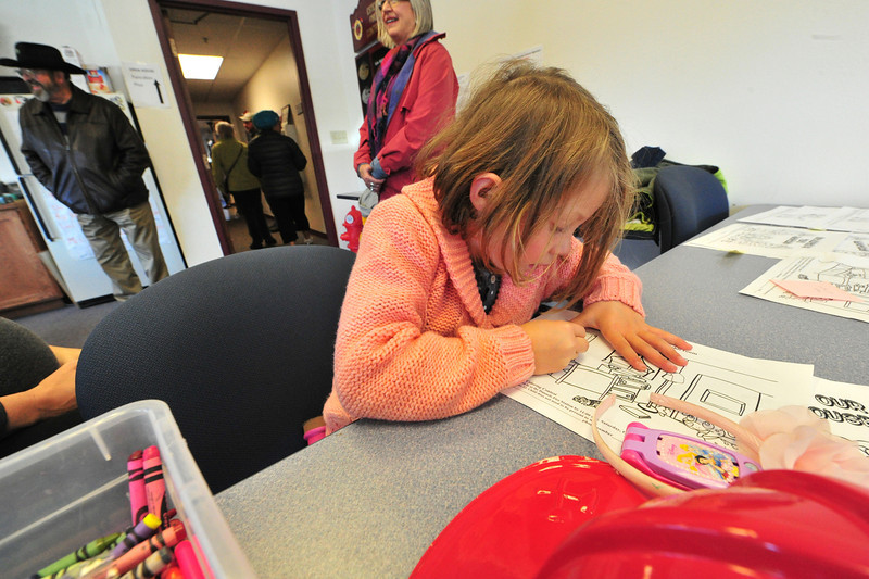 A young artist colors her entry in the fire district's coloring contest on Saturday. The contest was part of the district's open house at the Dannels Fire House, including a firefighter clown, tours and education of the equipment and a pancake breakfast.