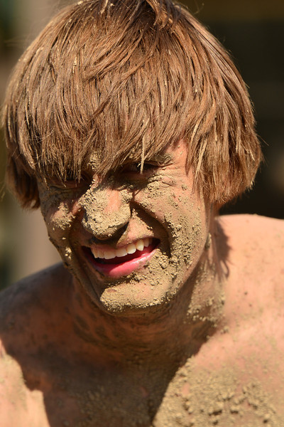 Eagle Rock student Nick Hayden seems okay with being covered in mud on Saturday. Hayden and many more played volleyball in the mud of the Stanley Fairgrounds in the Flood Mud Volleyball tournament, a fund raiser for Estes Valley flood relief.